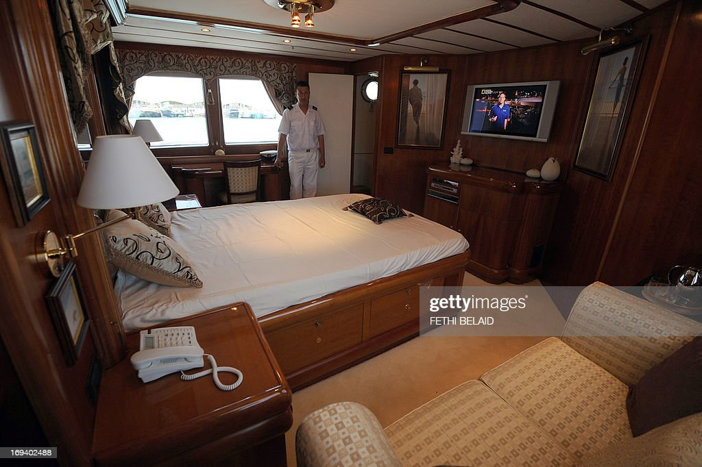 A picture shows the interior of the '5 Fishes' yacht which used to belong to Belhassen Trabelsi, the brother-in-law of ousted dictator Zine El Abidine Ben Ali, at the port of La Goulette in Tunis on May 24, 2013. Tunisian authorities have placed the yacht with an estimated value of eight million euros (over 10 million US dollars) on sale, but have so far received only one offer of seven million euros which they have refused. AFP PHOTO / FETHI BELAID