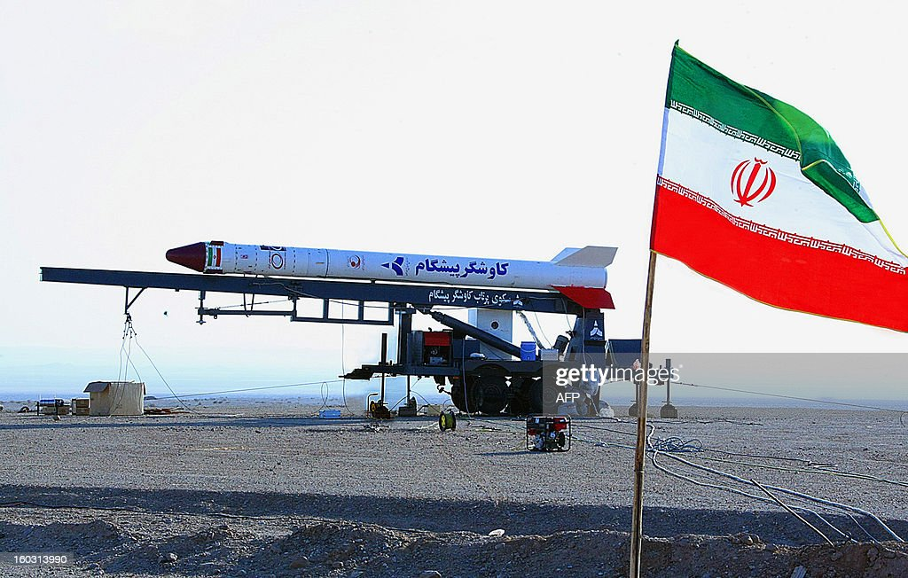A picture shows the Iranian flag fluttering in front of a capsule, codenamed Pishgam (Pioneer), containing a live monkey at an unknown location on January 28, 2013, which Iranian news agencies said returned alive after travelling to an altitude of 120 kilometres (75 miles) for a sub-orbital flight. Iran took a 'big step' towards sending astronauts into space by 2020, successfully launching a monkey above the Earth's atmosphere, Defence Minister Ahmad Vahidi told state television.