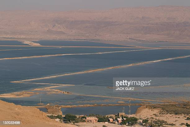 A picture shows the Israeli and Jordanian shores of the Dead Sea on November 9 2011 The Dead Sea may soon shrink to a lifeless pond as Middle East...