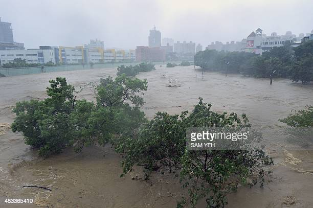 A picture shows the Jingmei river as typhoon Soudelor hits Taipei on August 8 2015 Typhoon Soudelor battered Taiwan with fierce winds and rain...