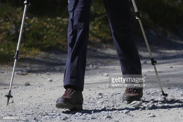 A picture shows the legs and boots of British Prime Minister Theresa May walking in a forest at the start of a summer holiday in the Alps in...