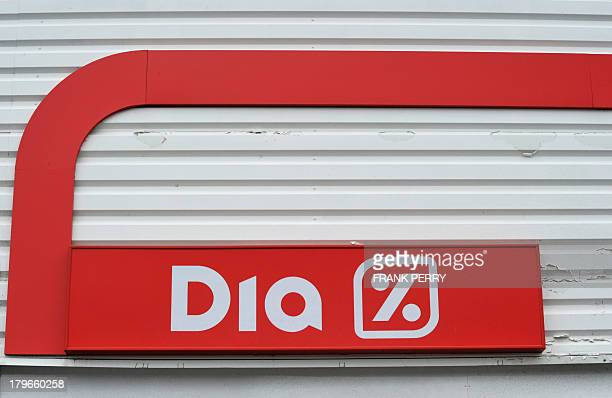 A picture shows the logo of Dia discount store during a protest by French vegetable producers demonstrating against the sale of vegetables imported...