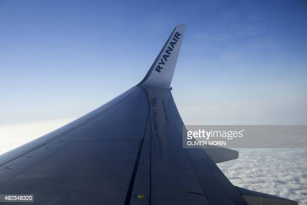 A picture shows the logo of Irish lowcost carrier Ryanair on the wing of a plane flying over the Italian Alps on July 1 2015 AFP PHOTO / OLIVIER MORIN