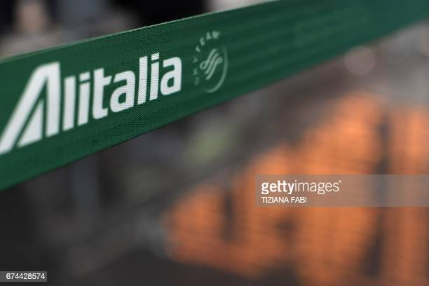 A picture shows the logo of Italian airline company Alitalia at Rome's Fiumicino airport on April 28 2017 / AFP PHOTO / Tiziana FABI