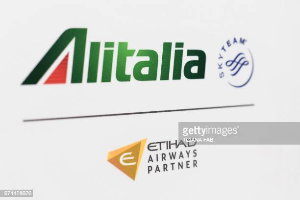 A picture shows the logo of Italian airline company Alitalia Sky team and Etihad airways at Rome's Fiumicino airport on April 28 2017 / AFP PHOTO /...