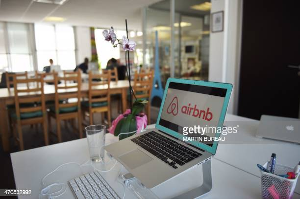 A picture shows the logo of online lodging service Airbnb displayed on a computer screen in the Airbnb offices in Paris on April 21 2015 AFP PHOTO /...