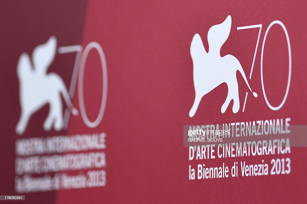 A picture shows the logo of the 70th Venice Film Festival few hours before the opening ceremony on August 28, 2013 at Venice Lido. The Venice film festival kicks off today with the arrival of movie stars on water taxis for a dark line-up flush with fiendish tales of abuse, betrayal and survival. The world's oldest film festival opens with 'Gravity', a 3-D sci-fi thriller starring George Clooney and Sandra Bullock as astronauts who are flung into deep space when a debris shower destroys their shuttle.