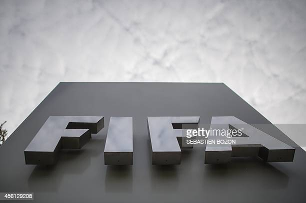 Picture shows the logo of the FIFA in front of the organisation's head office in Zurich on September 26 on the last day of the meeting of the...