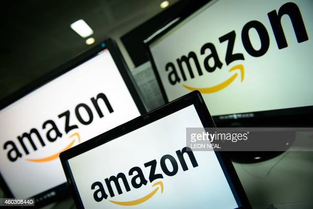 A picture shows the logo of the online retailer Amazon dispalyed on computer screens in London on December 11 2014 Online retail giant Amazon scored...