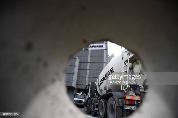 A picture shows the logo on a cement mixer of French cement company Lafarge at one of its plants on April 7 2014 in Paris Swiss cement group Holcim...