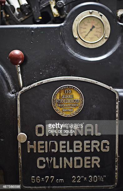 A picture shows the manufacturer's plate on an old original Heidelberg printing press at the Daha printing press in Mogadishu on March 26 2015 The...