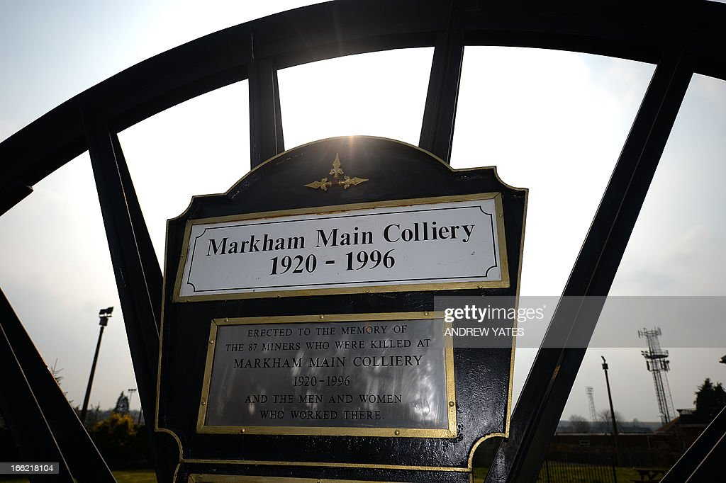 A picture shows the Markham Main Colliery remembrance garden in Armthorpe, Doncaster, northern England on April 9, 2013. Armthorpe was effected by then prime minister Margaret Thatcher's policy of coal mine closure, eventually losing its 76-year-old Markham Main Colliery in 1996. One of the few visible reminders of the village's mining history is a huge wheel from the pit that stands as a memorial along the main road. AFP PHOTO / ANDREW YATES