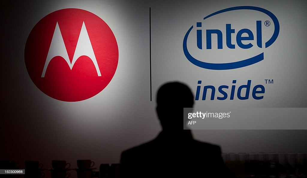 A picture shows the Motorola and Intel branding logos during the press launch of the new Motorola RAZRi smartphone with an Intel processor in London on September 18, 2012. Motorola Mobility presented their new smartphone, developed with an Intel processor powering its Android operating system, which will be launched in October in Europe and Latin America with the hope that it will compete with the Apple iPhone.