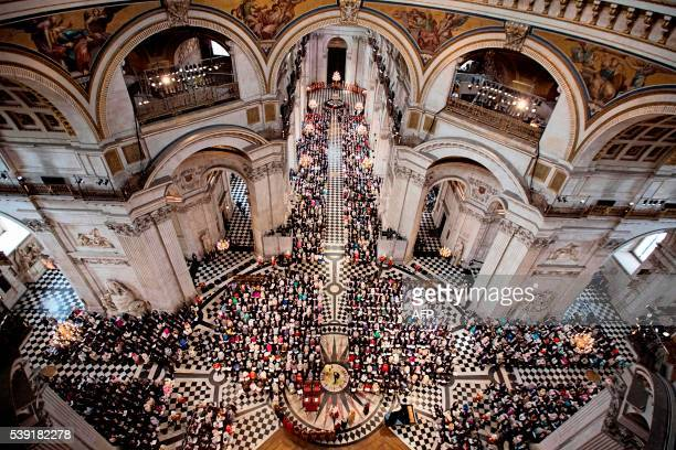 A picture shows the national service of thanksgiving for the 90th birthday of Britain's Queen Elizabeth II at St Paul's Cathedral in London on June...