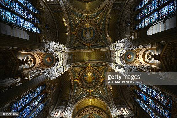A picture shows the new lighting of the Fourviere Basilica after seven years of restoration on March 5 2013 in Lyon AFP PHOTO / PHILIPPE DESMAZES