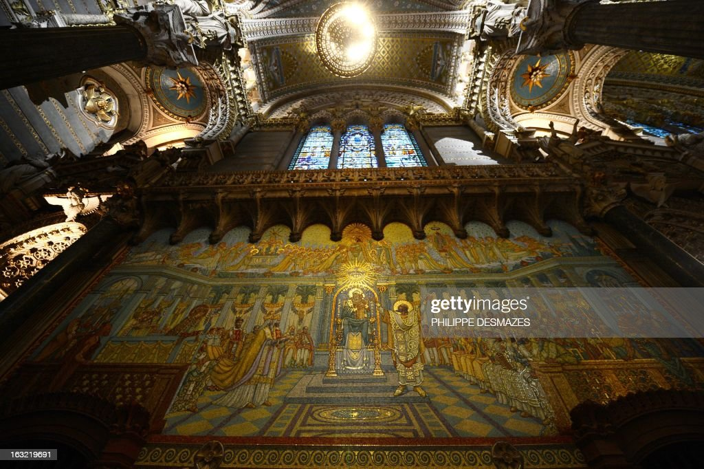 A picture shows the new lighting of the Fourviere Basilica after seven years of restoration on March 5, 2013 in Lyon. AFP PHOTO / PHILIPPE DESMAZES