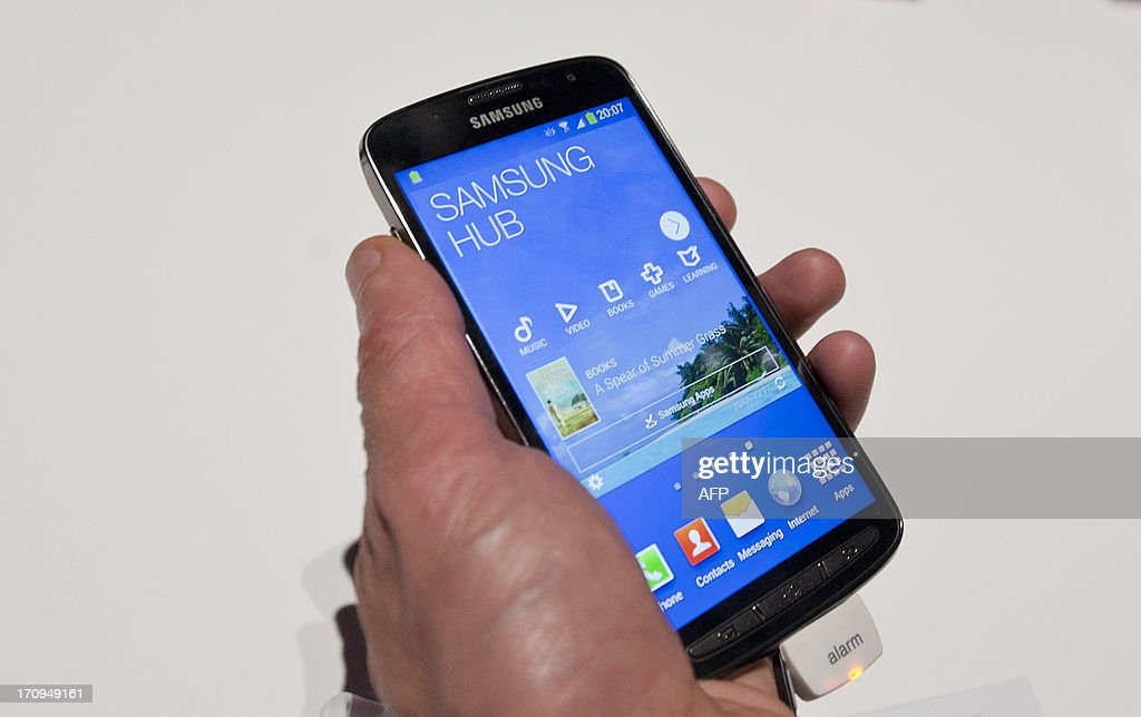 A picture shows the new Samsung S4 Zoom phone, a new design featuring a phone and camera combination during the world launch of new Samsung Galaxy and Ativ products at Earls Court, London on June 20, 2013.