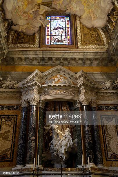 A picture shows the newly restored sculpture by Italian artist Gian Lorenzo Bernini 'The Ecstasy of Saint Teresa' unveiled in the Cornaro Chapel of...