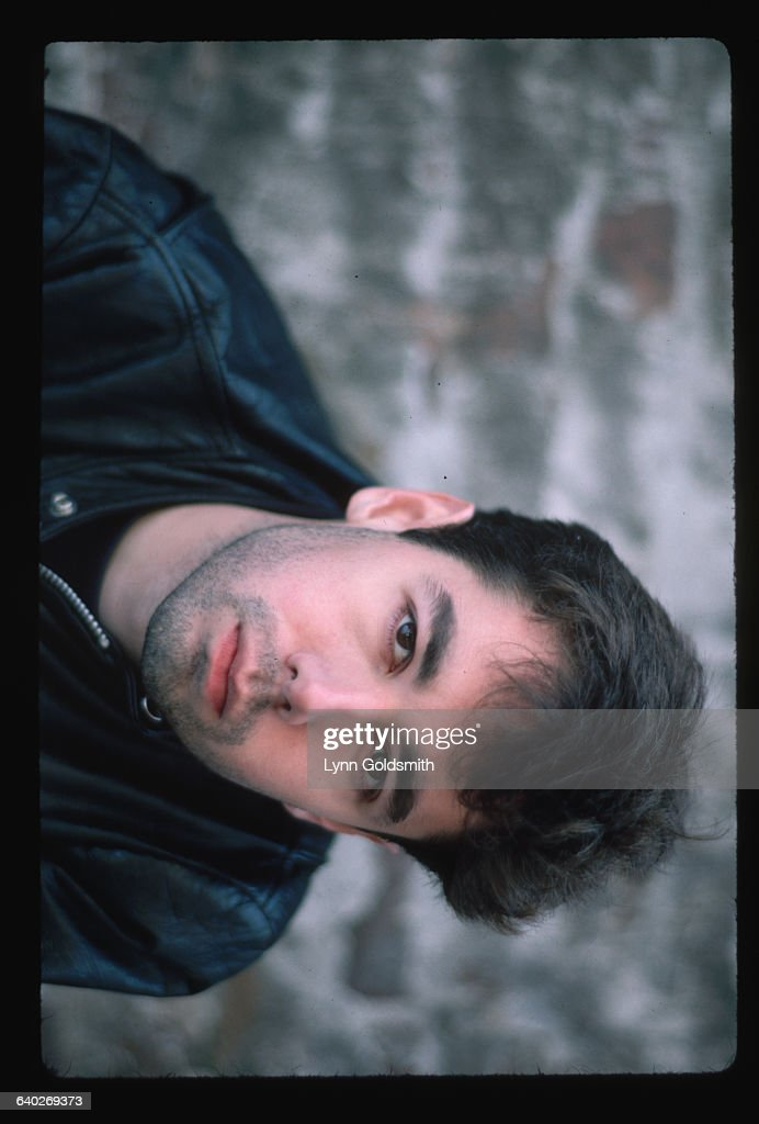 1987 Picture shows the one of the Beastie Boys Adam Yauch posing in front of a brick wall He is shown from the shoulders up and he is wearing a black...