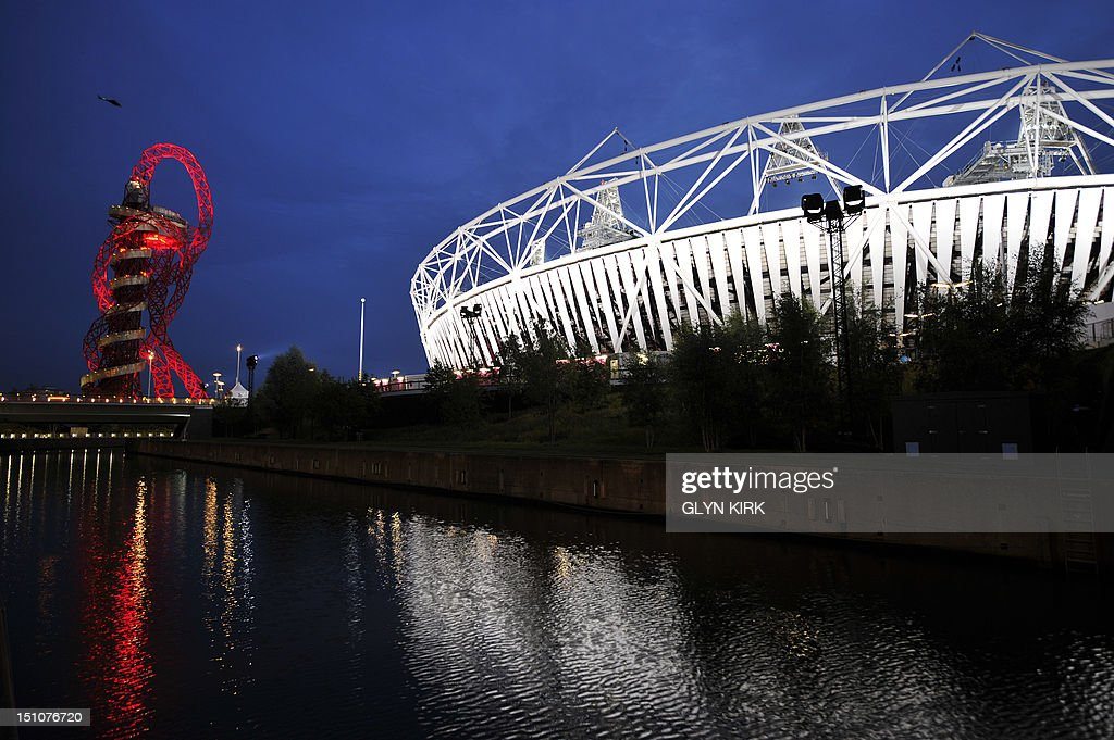 A picture shows the Orbit (L) and the Olympic Stadium (R) during the London 2012 Paralympic Games at the Olympic Park in east London on August 31, 2012. AFP PHOTO / GLYN KIRK
