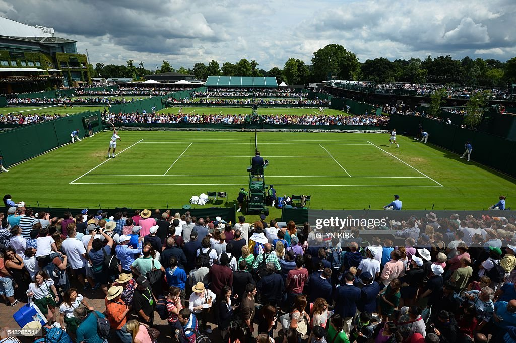 A picture shows the outer courts during play on the first day of the 2016 Wimbledon Championships at The All England Lawn Tennis Club in Wimbledon, southwest London, on June 27, 2016. / AFP / GLYN
