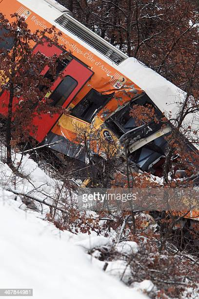 A picture shows the passenger train hit by a massive falling boulder near DignelesBains in the French Alps on February 8 2014 Two women were killed...