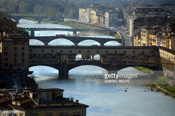 A picture shows the Ponte Vecchio over the Arno River on April 8 2015 in Florence AFP PHOTO / GABRIEL BOUYS