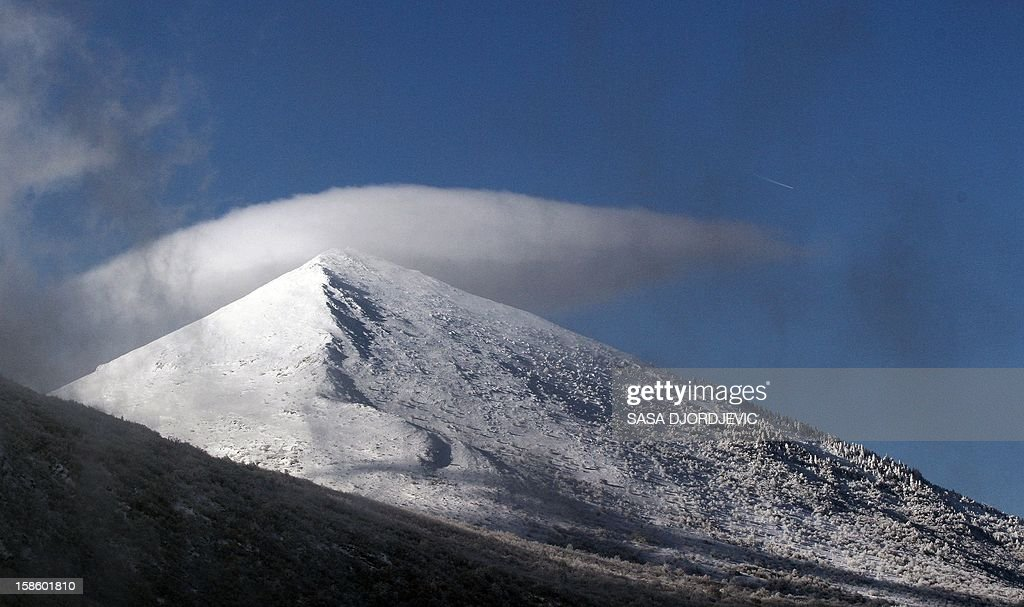 A picture shows the pyramid-shaped Siljak peak in the Serbian mountain of Rtanj on December 20, 2012. Visitors were flocking to the pyramid-shaped mountain in southeastern Serbia, ahead of the Mayan-foretold 'doomsday', local officials said Thursday. Hotel beds near Rtanj mountain, had been booked up well in advance, local tourist officials said. AFP PHOTO / SASA DJORDJEVIC