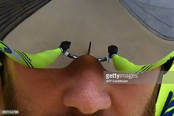 A picture shows the reflection in the glasses of France's Benjamin Edelin during the Elite of the French championships on August 16 2017 at the...