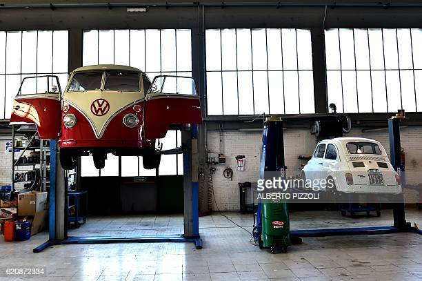 A picture shows the restoration of a vintage Volkswagen Kombi bus and of a Fiat500 by the 'T1 specialist' team on November 3 2016 at the garage Nucci...