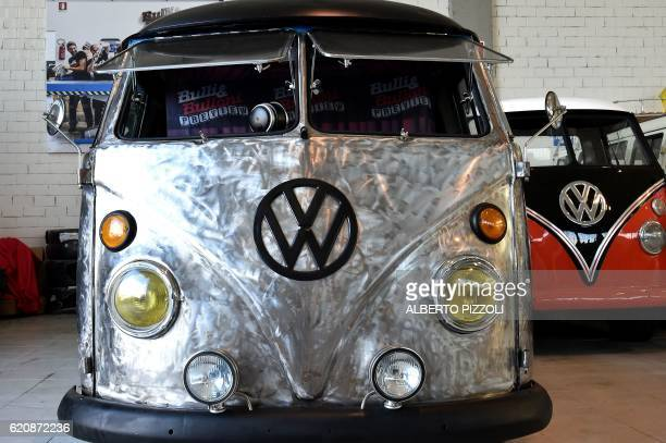 A picture shows the restoration of a vintage Volkswagen Kombi bus by the 'T1 specialist' team on November 3 2016 at the garage Nucci in Florence...