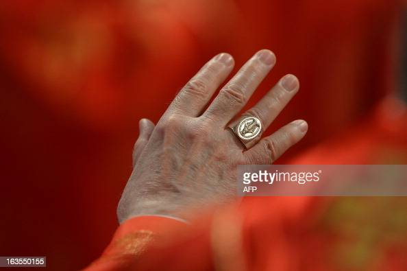 A picture shows the ring of a cardinal during a mass at the St Peter's basilica before the conclave on March 12 2013 at the Vatican Cardinals moved...