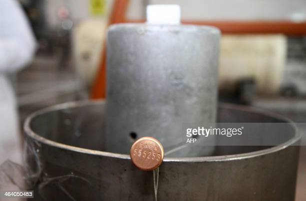 A picture shows the seal of the connections between the twin cascades for 20 percent uranium production bearing the initials of the International...