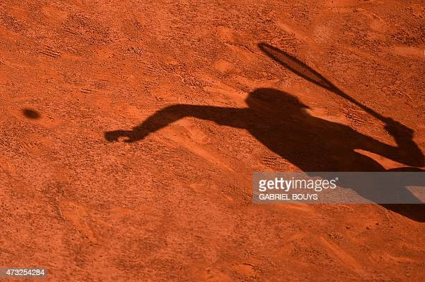 A picture shows the shadow of Spanish player Rafael Nadal serving against US John Isner during the ATP Tennis Open tournament at the Foro Italico in...
