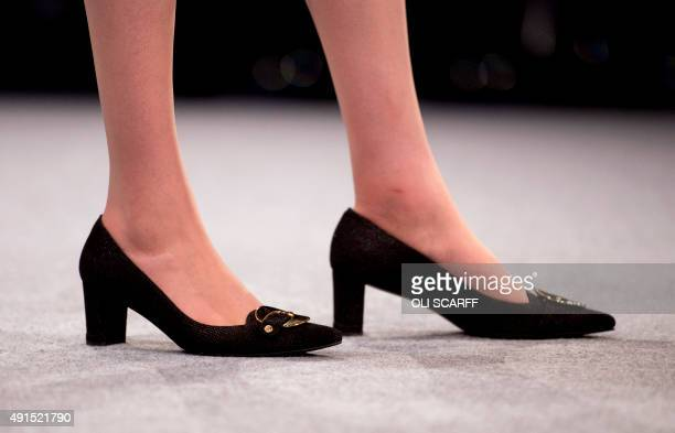A picture shows the shoes of Britain's Home Secretary Theresa May as she addresses delegates on the third day of the annual Conservative party...