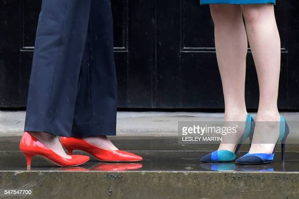 A picture shows the shoes of Britain's new Prime Minister Theresa May as she is greeted by Scotland's First Minister Nicola Sturgeon as she arrives...