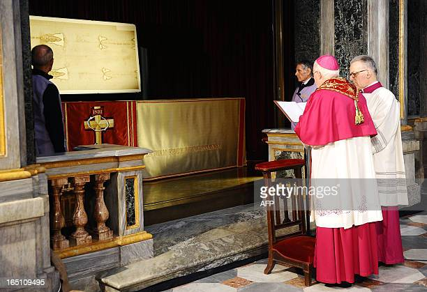 A picture shows 'The Shroud of Turin' on March 30 2013 in the Turin cathedral On Holy Saturday the linen cloth imprinted with the faint brownish...