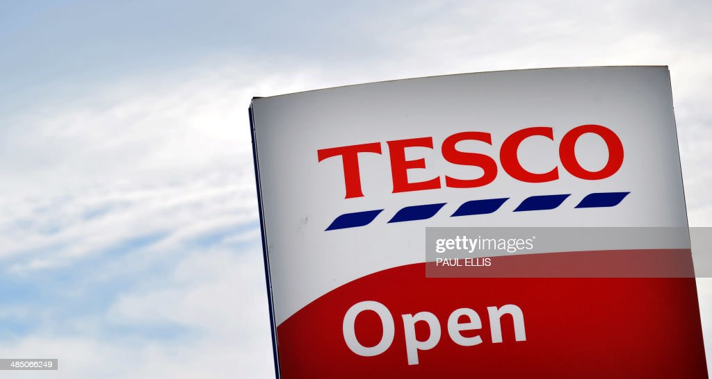 A picture shows the sign outside a Tesco store in Liverpool, north west England on April 16, 2014. Supermarket giant Tesco announced a second drop in annual profits in a row on April 16, leaving Britain's biggest retailer hoping that recent expansion into India and China can offset weakness in Europe. AFP PHOTO / PAUL ELLIS