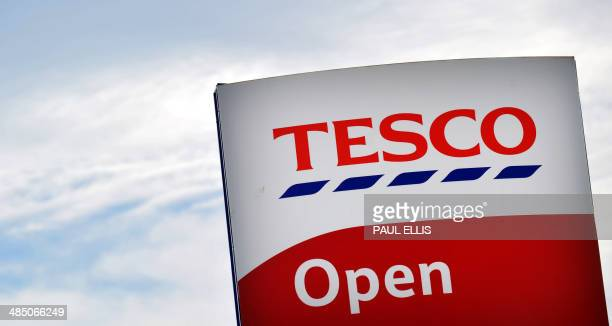 A picture shows the sign outside a Tesco store in Liverpool north west England on April 16 2014 Supermarket giant Tesco announced a second drop in...