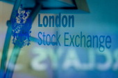 A picture shows the signage of the London Stock Exchange in central London on March 7 2013 AFP PHOTO / LEON NEAL