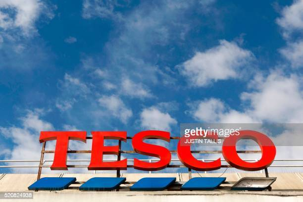 A picture shows the signage on a branch of a Tesco in Brixton south London on April 13 2016 Tesco said on April 13 that it rebounded into slender...