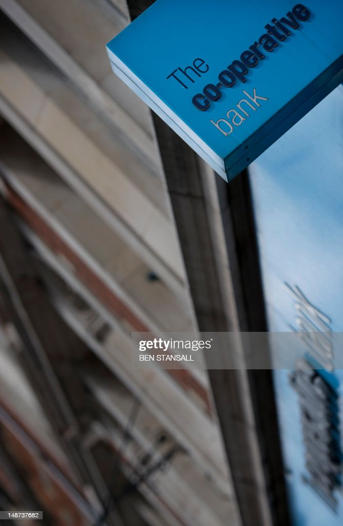 A picture shows the signage on the front of a branch of the Co-operative Bank in London on July 19, 2012. Britain's retail bank sector faced further shake-up on July 19 as state-rescued Lloyds Banking Group agreed to sell 632 branches at a loss to The Co-operative Group after an EU competition ruling. AFP PHOTO / BEN STANSALL