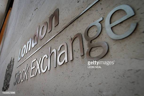 A picture shows the signage outside the entrance of the London Stock Exchange in central London on March 7 2013 AFP PHOTO / LEON NEAL