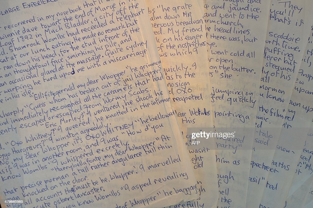 A picture shows 'The singularge experience of Miss Anne Duffield', an autograph manuscript by British musician John Lennon, at Sotheby's auction house in London on March 21, 2014 expected to realise USD 50,000 - 70,000 as part of the 'You Might Well Arsk' sale.