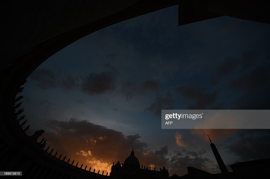 A picture shows the St Peter's basilica and the Colonnade at sunset on the eve of the conclave on March 11, 2013 at the Vatican. Catholic cardinals had a final day of jockeying for position the same day before shutting themselves into the Sistine Chapel to elect a new pope after Benedict XVI's shock resignation, with an Italian and a Brazilian who both head powerful archdioceses among the top contenders. AFP PHOTO / FILIPPO MONTEFORTE