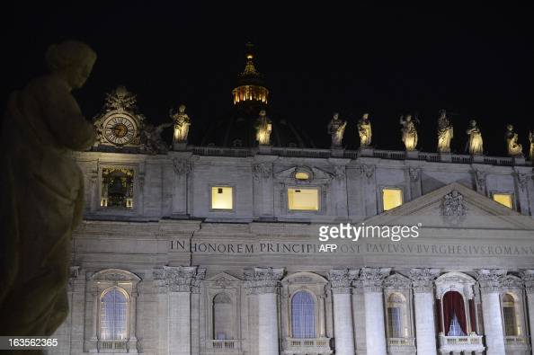 A picture shows the St Peter's basilica at night during the conclave on March 12 2013 at the Vatican Cardinals moved into the Vatican today as the...