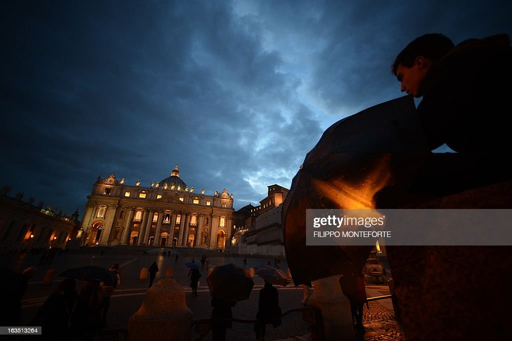 A picture shows the St Peter's basilica at night on the eve of the conclave on March 11, 2013 at the Vatican. Catholic cardinals had a final day of jockeying for position the same day before shutting themselves into the Sistine Chapel to elect a new pope after Benedict XVI's shock resignation, with an Italian and a Brazilian who both head powerful archdioceses among the top contenders. AFP PHOTO / FILIPPO MONTEFORTE