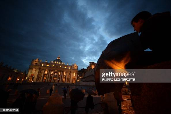 A picture shows the St Peter's basilica at night on the eve of the conclave on March 11 2013 at the Vatican Catholic cardinals had a final day of...