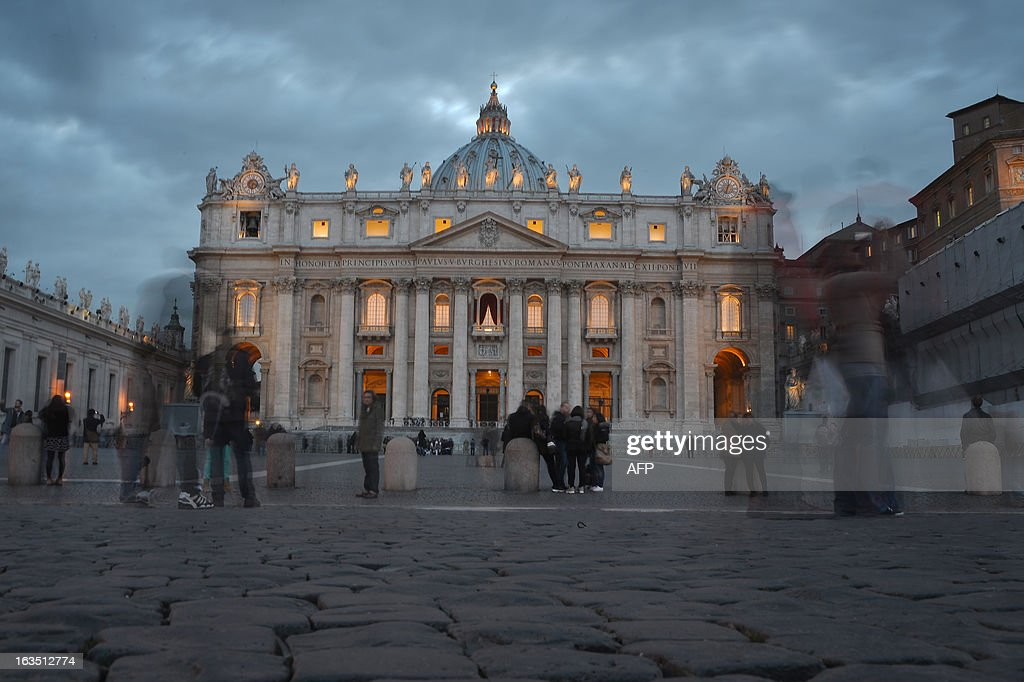A picture shows the St Peter's basilica at sunset on the eve of the conclave on March 11, 2013 at the Vatican. Catholic cardinals had a final day of jockeying for position the same day before shutting themselves into the Sistine Chapel to elect a new pope after Benedict XVI's shock resignation, with an Italian and a Brazilian who both head powerful archdioceses among the top contenders. AFP PHOTO / GABRIEL BOUYS