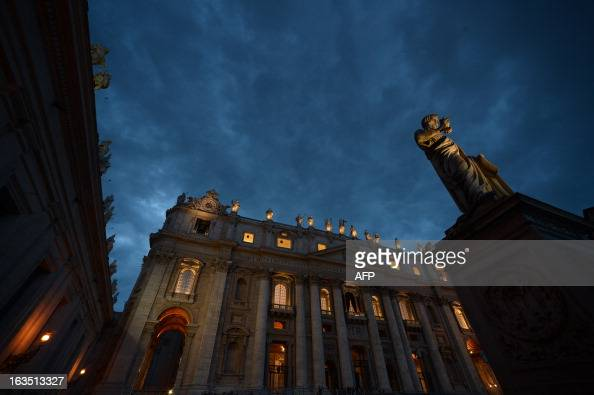 A picture shows the St Peter's basilica at sunset on the eve of the conclave on March 11 2013 at the Vatican Catholic cardinals had a final day of...